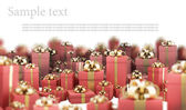 Beautiful red gift boxes with gold ribbon isolated on white background 3D r — Stock Photo