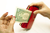 Red purse in hands with dollar — Stock Photo