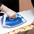 Process of ironing of a white dressing — Stockfoto