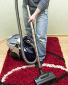 Cleaning by the vacuum cleaner — Stock Photo
