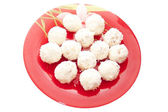 White cakes on a red plate — 图库照片