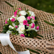 Pink and white wedding bouquet of roses in a hammock — Stock Photo