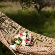 Pink and white wedding bouquet of roses in a hammock — Photo