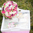Pink and white wedding bouquet in delicate tones on the grass — Stock Photo #9172531