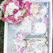 Pink and white wedding bouquet in delicate tones on the grass — Stock Photo #9172534