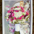 Stock Photo: Pink and white wedding bouquet in delicate tones on grass