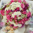 Pink and white wedding bouquet in delicate tones on the grass — Stock Photo