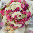 Pink and white wedding bouquet in delicate tones on the grass — Stock Photo #9172554