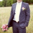 Pink and white wedding bouquet of roses in the hands of the groo — Photo