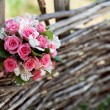 Stock Photo: Pink and white wedding bouquet of roses on tree