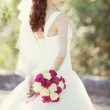 Pink and white wedding bouquet of roses in the hands of the brid — Stock Photo #9172637