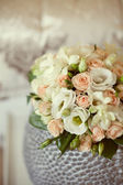 Pink and white wedding bouquet in a vase — Stock Photo