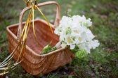 White bridal bouquet in a basket — Stock Photo