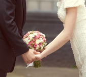 Pink and white wedding bouquet in the hands of the bride and gro — Stock Photo