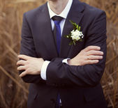 Groom in a wedding jacket with a ring on his hand — Stock Photo