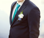 Groom in a wedding jacket with boutonniere — Stok fotoğraf