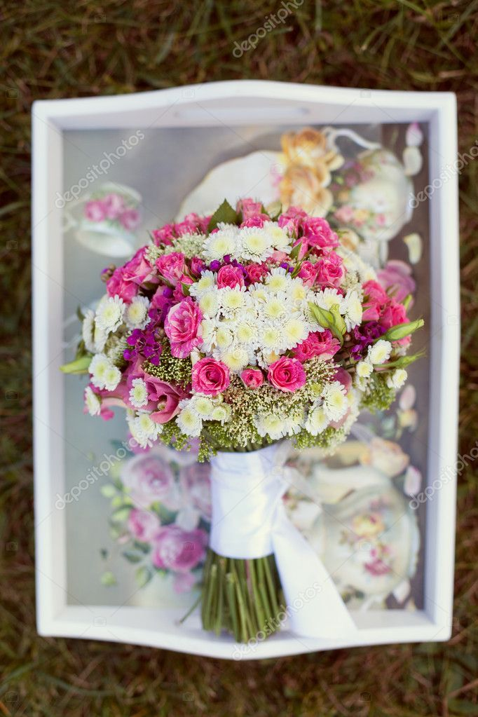 Pink and white wedding bouquet in delicate tones on the grass  Stock Photo #9172549