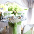 Gorgeous wedding chair and table setting for fine dining at outd - Stock Photo