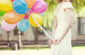 Bride with colored balloons in their hands — Stock Photo