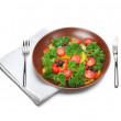 Fresh salad with fork and knife - Stock Photo