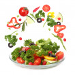 Fresh salad and falling vegetables — Stock Photo
