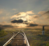 Evening landscape with railroad rails — Stock Photo
