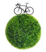 Bicycle and grass sphere — Stock fotografie