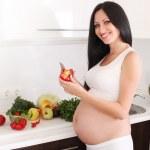 Pregnant woman in kitchen — Stock Photo #9757852