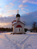 Church in the winter at sunset — Stock Photo