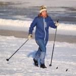 Girl runs on skis — Stock Photo #8755771