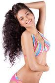 Happy young woman in bikini isolated — Stock Photo