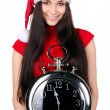 Young Happy Christmas Woman holding clock - Stock Photo