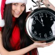 Young Happy Christmas Woman holding clock — Stock Photo #7991834
