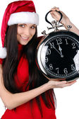 Young Happy Christmas Woman holding clock — Stock Photo