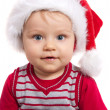 Adorable christmas child in a red hat - Stock Photo
