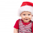 Adorable christmas child in a red hat — Stock Photo