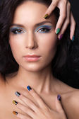 Beautiful young woman with fashion make-up and manicure — Stock Photo