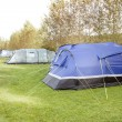 Tents in a row on a campsite - Stock Photo