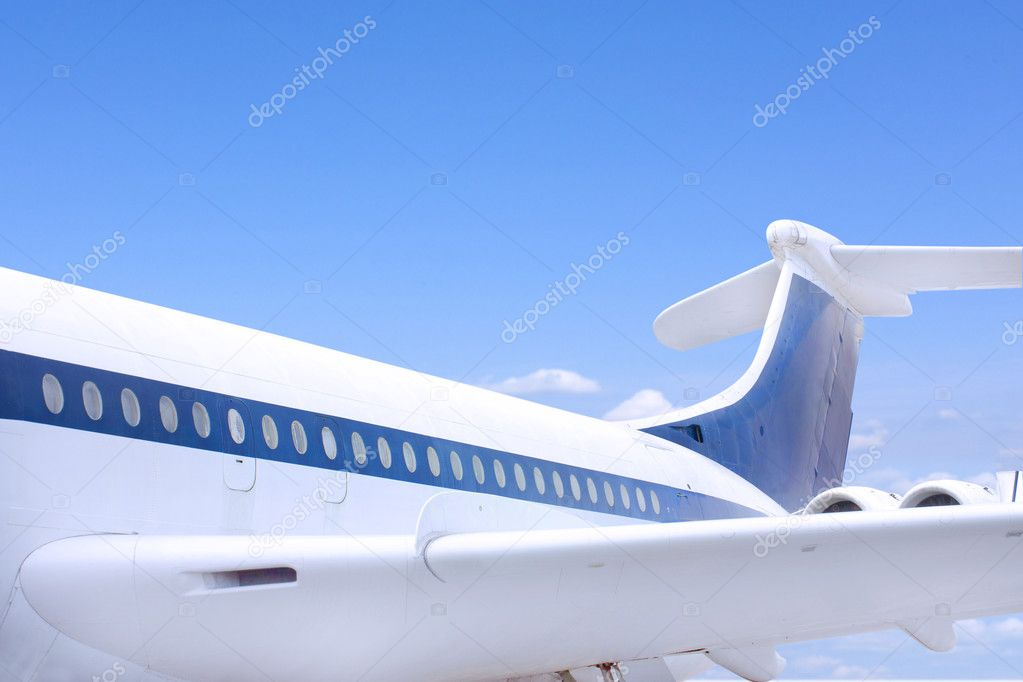 Airbus style aeroplane flying against a blue sky  Stock Photo #8752420