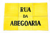 Yellow portuguese tile plaque — Stock Photo