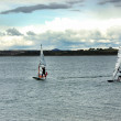 Stock Photo: Windsurfing on alquevlake, Portugal