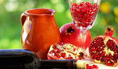 Pomegranate and glass of red wine — Photo
