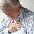 Man with severe chest pain - Stock Photo