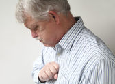 Senior man suffers from bad heartburn — Stock Photo