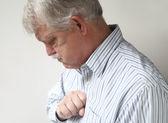 Senior man suffers from bad heartburn — Stock Photo