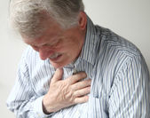 Man with severe chest pain — Stok fotoğraf
