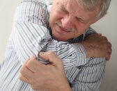Senior man with painful joints — Foto Stock