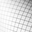 Curving sheet of graph paper — Stock Photo