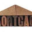 Mortgage word with roof made of blocks — Stock Photo #10174008