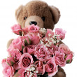 Teddy bear with pink roses — Stock Photo